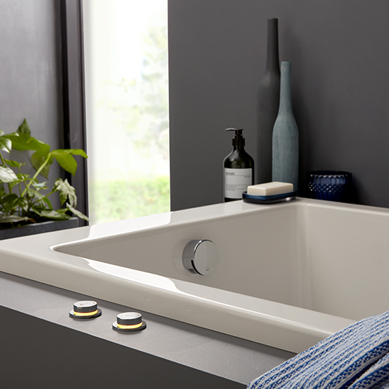 Lifestyle Photograph Featuring Sensori SmartDial and a Bath Filler Waste in a Contemporary Bathroom Setting