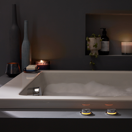 Lifestyle Photograph Featuring Sensori SmartDial and a Bath Filler Waste in a Relaxing Bathroom Setting
