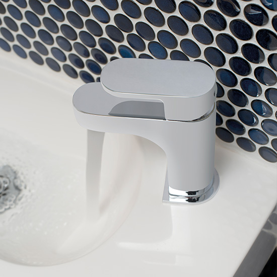 Lifestyle Photograph Featuring a Life Mini Mono Basin Mixer Tap in a Cloakroom with Bold Blue Circular Tiles