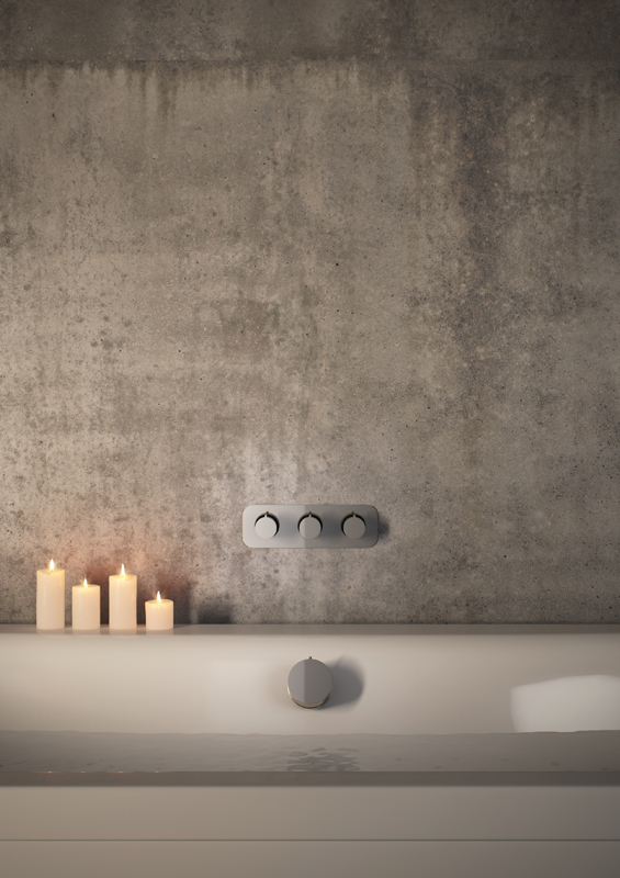 Lifestyle Photograph Featuring a Tablet Altitude Horizontal 3 Handle Valve over a Bath Filler Waste with Candles