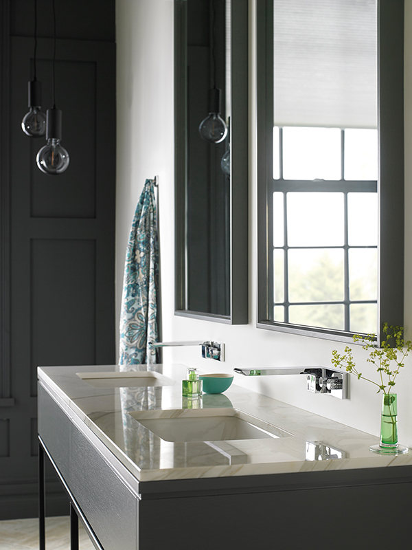 Lifestyle Photograph Featuring Two Omika Wall Mounted Basin Mixer Taps on a Luxury Marble Double Basin