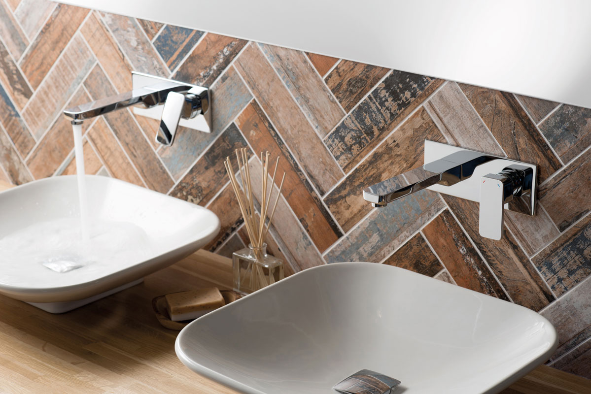 Lifestyle Photograph Featuring Two Phase Wall Mounted Basin Mixer Taps on His and Her Basins