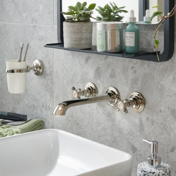 Lifestyle Photograph of a BOOTH & Co. Axbridge Wall Mounted Basin Mixer Tap and Ceramic Tumbler and Holder