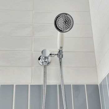 Lifestyle Photograph featuring a BOOTH & Co. Single Function Mini Shower Kit with Integrated Outlet