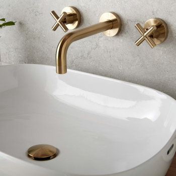 Lifestyle Photograph for an Individual by VADO Brushed Gold Elements Wall Mounted Basin Mixer Tap and Universal Basin Waste