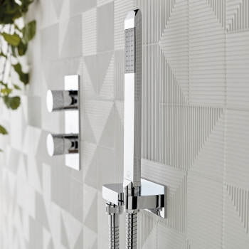 Lifestyle Photograph with an Omika Single Function Mini Shower Kit with Integrated Outlet and an Omika Tablet Thermostatic Shower Valve