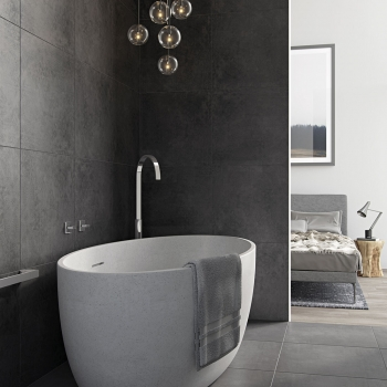 Lifestyle Photograph of the Geo Floor Mounted Bath Spout with Geo Wall Mounted Stop Valves